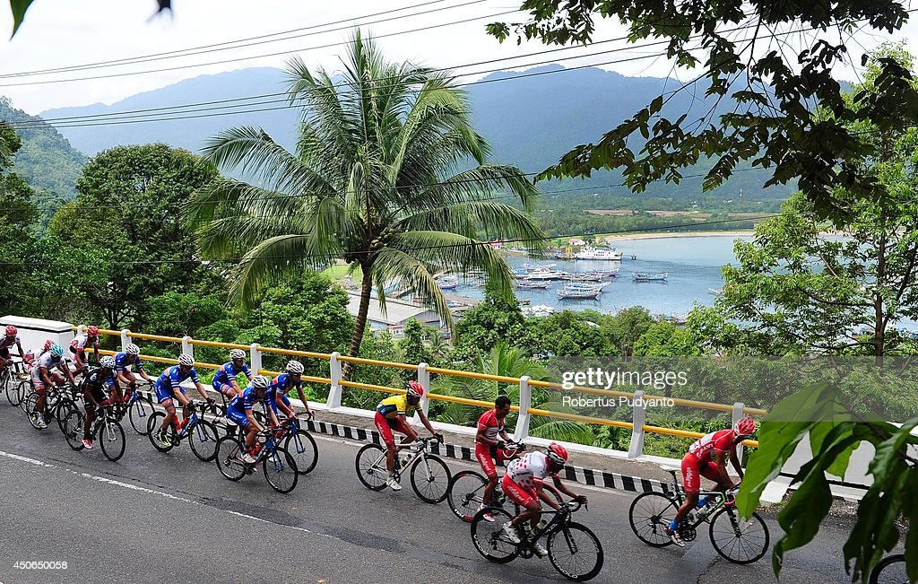Cyclist compete as they pass Teluk Bayur Port during stage 9 of the 2014 Tour de Singkarak from Pesisir Selatan to Padang City with a distance of 120.5 km on June 15, 2014 in Padang, Indonesia.