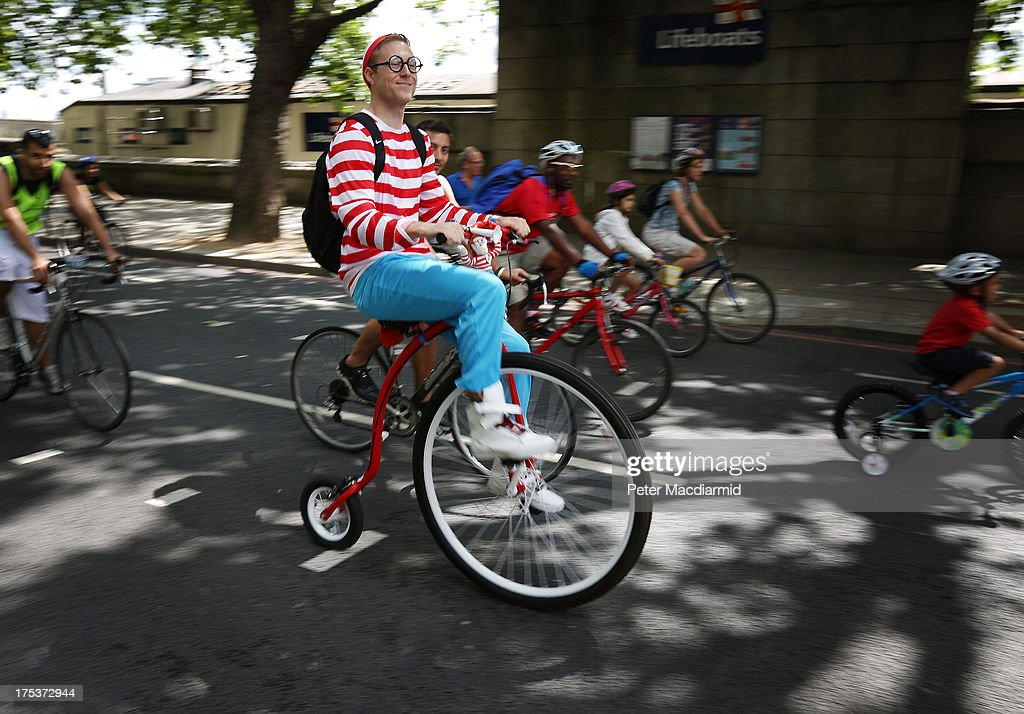 A cyclist dressed as children's character 'Where's Wally' takes part in the Ride London Freecycle event on August 3, 2013 in London, England. Up to 50, 000 cyclists are expected to ride the eight mile traffic free route through central London.