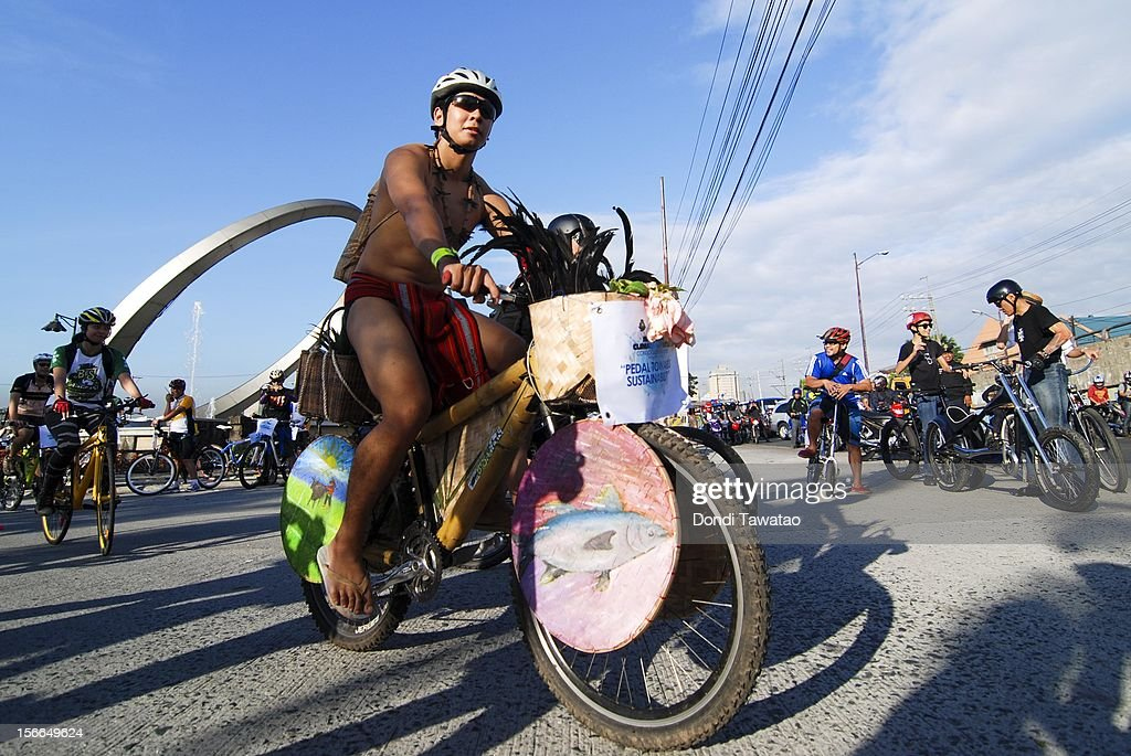 A cyclist dressed in native attire joins bikers in the streets during the annual Tour of the Fireflies cycling event on November 18, 2012 in Manila, Philippines. The annual event organized by the Firefly Brigade, a cycling group of environmentalists, aims to promote cycling as a sustainable form of transportation in Metro Manila and has become a rite of passage for a growing number of weekend cyclists from all walks of life.