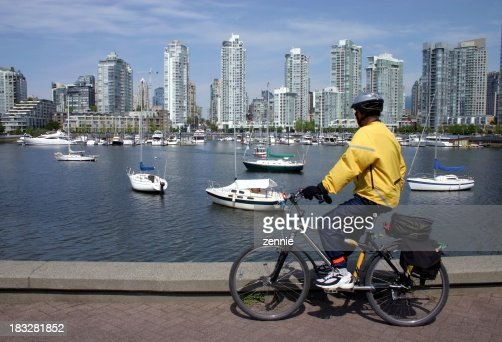 Cyclist Enjoying View Of Vancouver