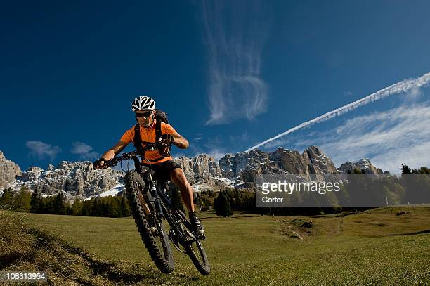 Cyclist enjoys nature in the Dolomites