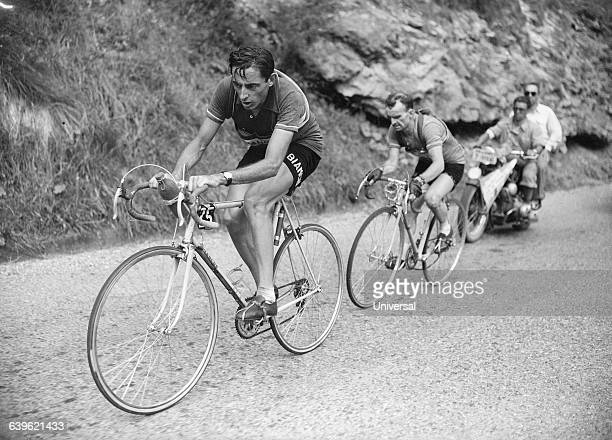 Cyclist Fausto Coppi leads Jean Robic in the tenth stage of the 1952 Tour de France | Location Between Lausanne Switzerland and l' Alped'Huez France