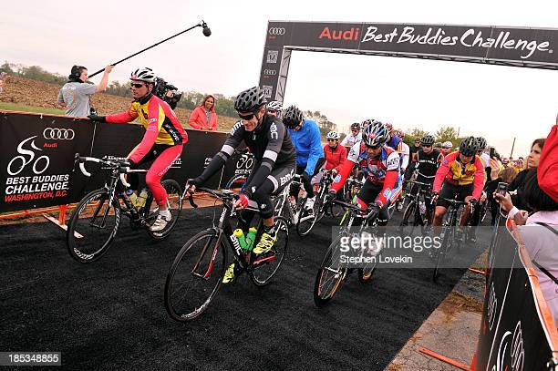 Cyclist George Hincapie bikes at the start of the 2013 Audi Best Buddies Challenge Washington DC on October 19 2013 at Poolesville Golf Course in...