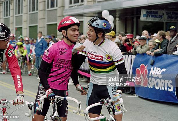 US cyclist Greg Lemond and Mexican cyclist Raul Alcala joke each other prior to the Wilmington to Baltimore road race of the Tour de Trump on May 04...
