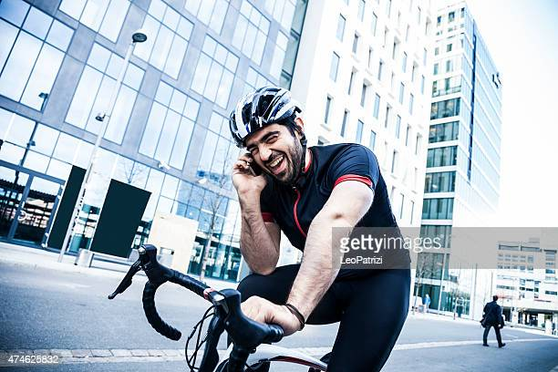 Cyclist having a call on mobile on the road