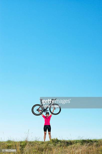 Cyclist holding bicycle