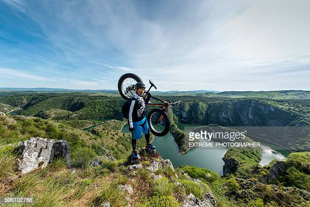 Cyclist holding his fat bike