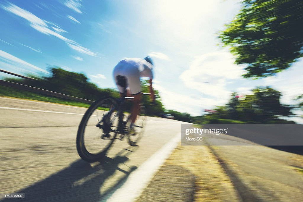 Cyclist in a Country Road