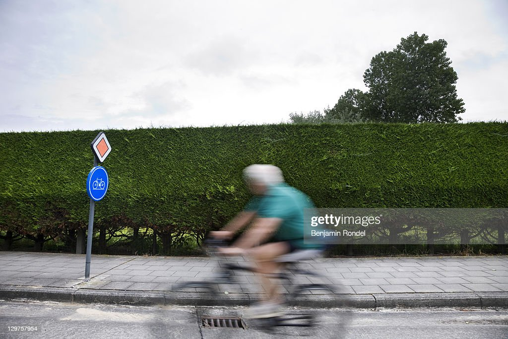 Cyclist in bicycle lane : Stock Photo