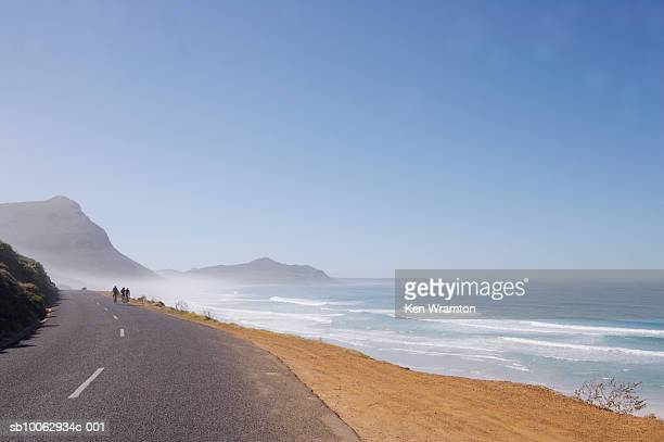 Cyclist in distance on coastal road