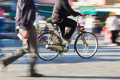 cyclist and pedestrian in motion blur
