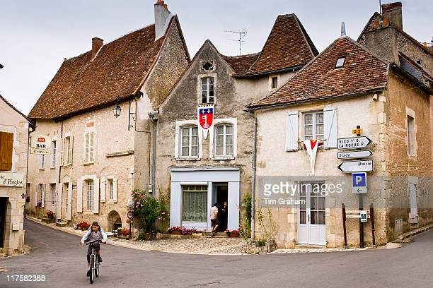 Cyclist in traditional French village of Angles Sur L'Anglin Vienne near Poitiers France