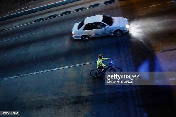 A cyclist is seen riding along one of the main streets of San Salvador after an event to promote healthy practices and to contribute to the...