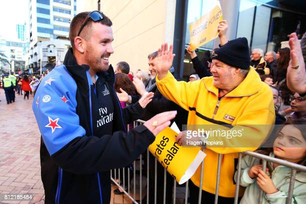 Cyclist Joe Sullivan speaks to fans during the Team New Zealand Americas Cup Wellington Welcome Home Parade on July 11 2017 in Wellington New Zealand