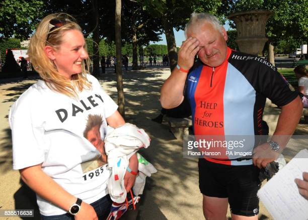 Cyclist John Gostick who lost his son Dale in Afghanistan a year ago is greeted by Dale's girlfriend Beckey Proberts at the Eiffel Tower after...
