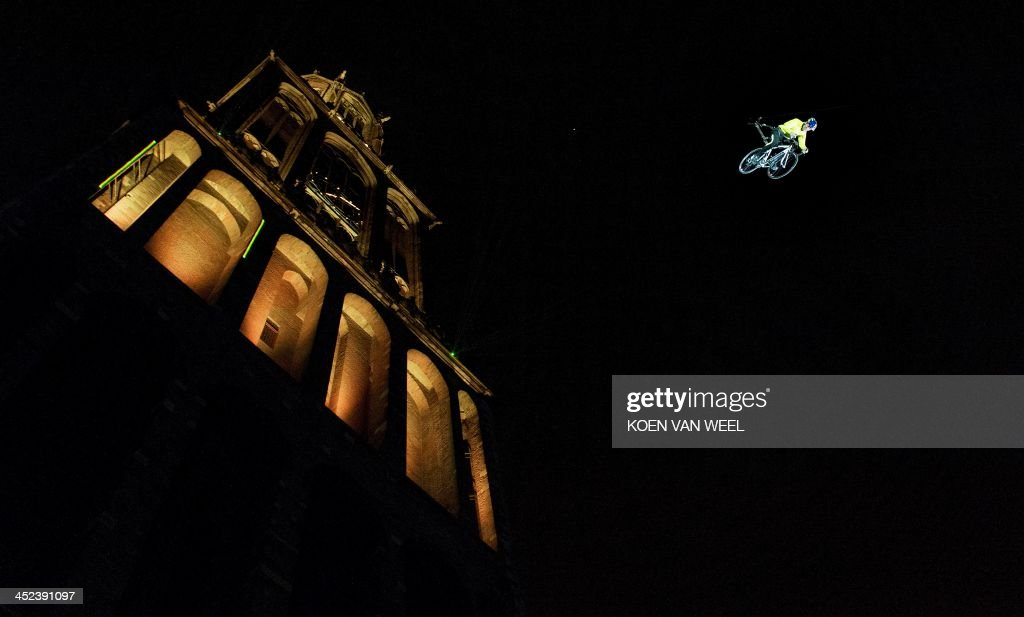 A cyclist jumps from the Dow tower in Utrecht, on November 28, 2013, to celebrate the Tour de France cycling race 2015 departure from Utrecht on July 4, 2015. Tour de France organisers Amaury Sports Organisation (ASO) revealed today that the opening stage of the Tour de France in 2015 will be an individual time-trial.