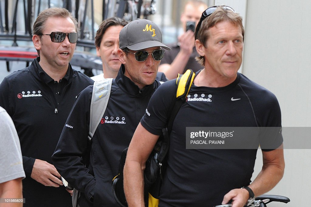 US cyclist Lance Armstrong (c) and team manager Astana team Johan Bruyneel (l)arrive in the paddock on June 2, 2010 in Luxembourg city, before the time-trial prologue on the ' Tour du Luxembourg ' 2010 .
