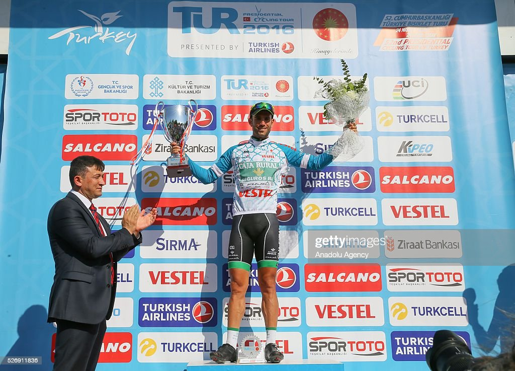 Cyclist Luis Mas Bonet (R) of Caja Rural-Seguros RGA receives his award after the final stage of 201,7 kilometers long Marmaris - Selcuk lap of the 52nd Presidential Cycling Tour of Turkey in Izmir, Turkey on May 1, 2016.