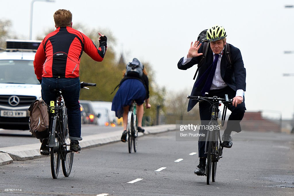 A cyclist makes a hand gesture to Mayor of London <a gi-track='captionPersonalityLinkClicked' href=/galleries/search?phrase=Boris+Johnson&family=editorial&specificpeople=209016 ng-click='$event.stopPropagation()'>Boris Johnson</a> as he cycles over Vauxhall Bridge to launch London's first cycle superhighway on November 19, 2015 in London, England. Superhighway 5 (CS5) is the capital's first two lane fully segregated cycle superhighway.