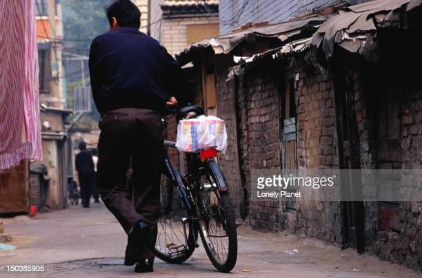 Cyclist making his way down Xiaojiao Hutong in Beijing.