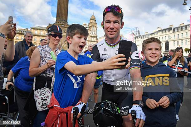 Cyclist Mark Cavendish is photographed by a young boy prior to the start of stage 1 of the Tour of Britain from Glasgow to Castle Douglas on...