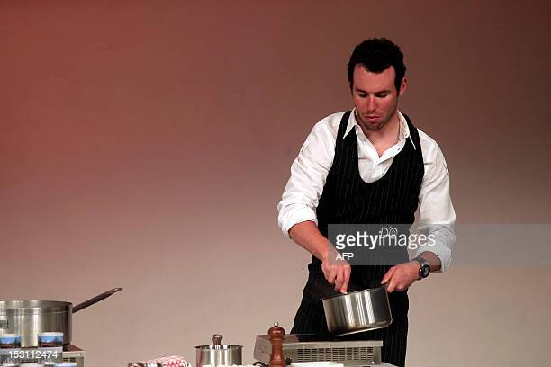 Cyclist Mark Cavendish of Great Britain takes part in a kitchen test during the presentation of the 96th Giro d'Italia 2013 route on September 30 in...