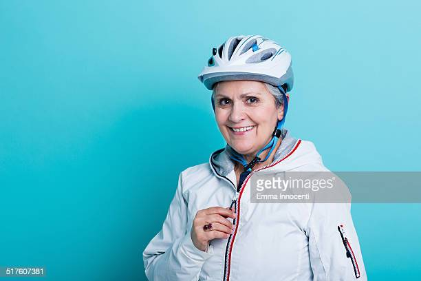 Cyclist mature woman with sport clothes