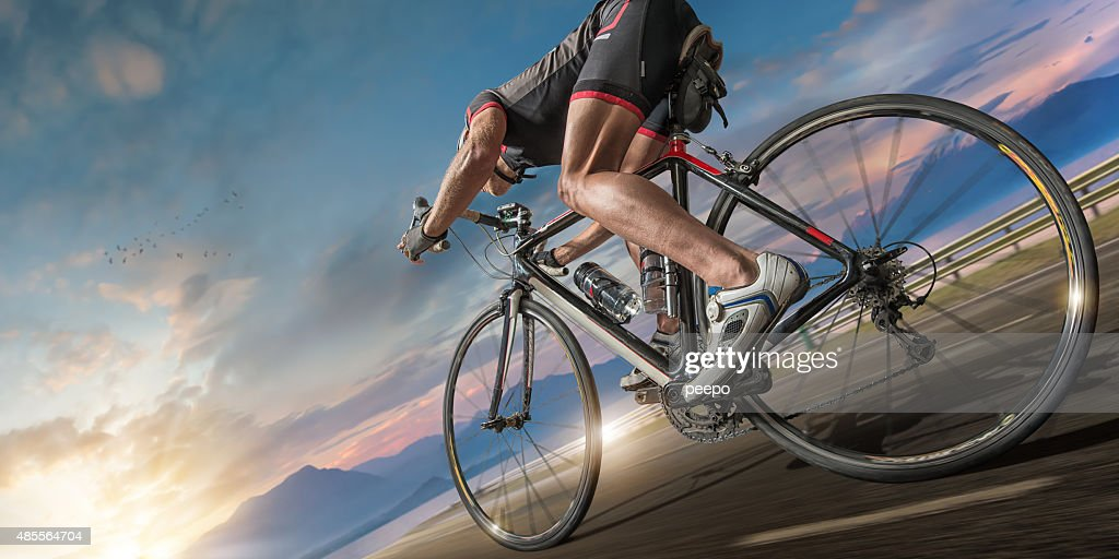 Cyclist Moving Fast On Coastal Path : Stock Photo
