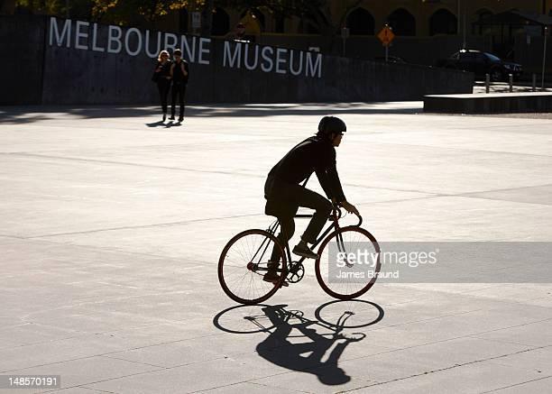 Cyclist near Melbourne Museum.