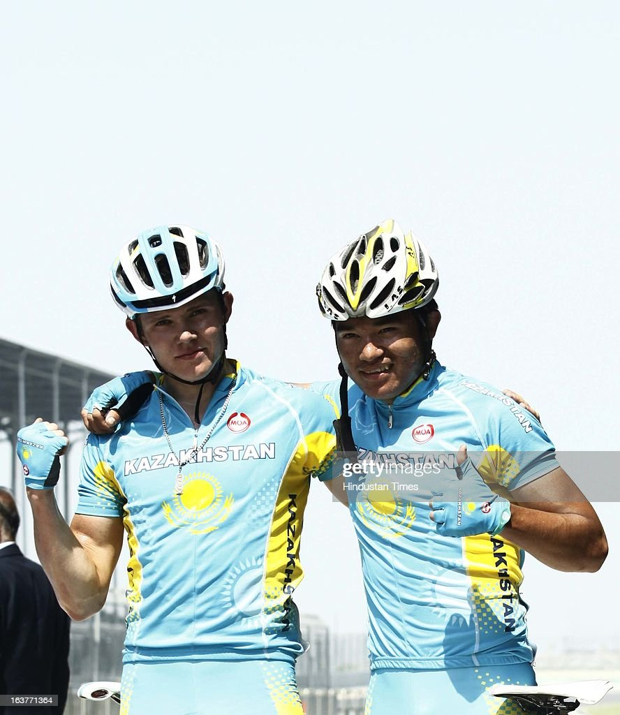 Cyclist of Kazakhstan Pernebekov Yerlan wins Gold Medal (R) and Rive Dmitrity Silver Medal (L) in the Individual Road Race – Men Junior for the Asian Cycling Championship Road Race at the Buddh International Circuit on March 15, 2013 in Greater Noida, India.