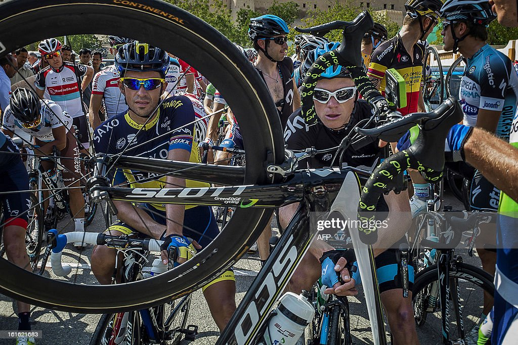 UK cyclist of Sky Pro Cycling team Christopher Froome (R) and Spanish cyclist of Saxo-Tinkoff team Alberto Contador (L) wait before the start of the third stage of the Tour of Oman, from Nakhal Fort to Wadi Dayqah Dam, on February 13, 2013, in Oman. The six-stage race, which follows the Tour of Qatar, won by Britain's Mark Cavendish last week, culminates on Saturday at Matra Corniche.