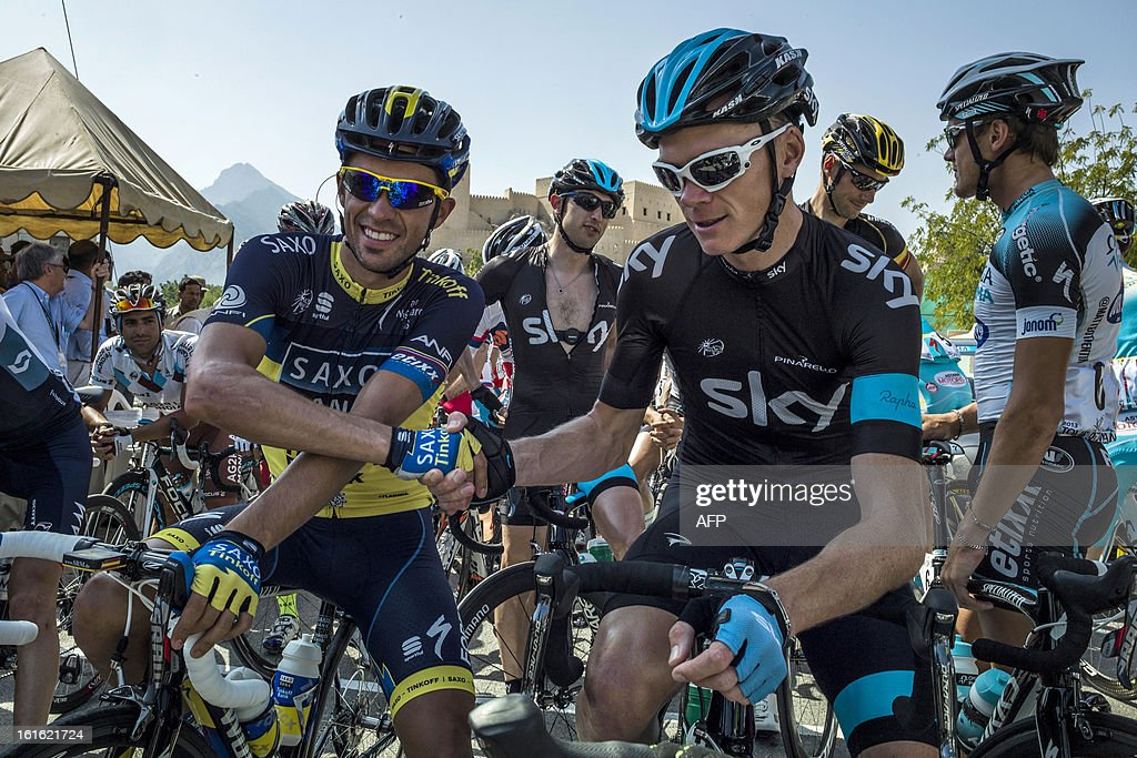 UK cyclist of Sky Pro Cycling team Christopher Froome (R) and Spanish cyclist of Saxo-Tinkoff team Alberto Contador (L) shake hands before the start of the third stage of the Tour of Oman, from Nakhal Fort to Wadi Dayqah Dam, on February 13, 2013, in Oman. The six-stage race, which follows the Tour of Qatar, won by Britain's Mark Cavendish last week, culminates on Saturday at Matra Corniche.