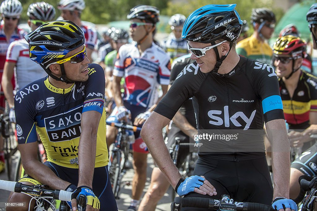 UK cyclist of Sky Pro Cycling team Christopher Froome (R ) discusses with Spanish cyclist of Saxo-Tinkoff team Alberto Contador (L) before the start of the third stage of the Tour of Oman, from Nakhal Fort to Wadi Dayqah Dam, on February 13, 2013, in Oman. The six-stage race, which follows the Tour of Qatar, won by Britain's Mark Cavendish last week, culminates on February 16 at Matra Corniche.