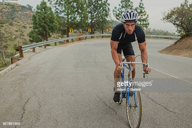 Cyclist on uphill road