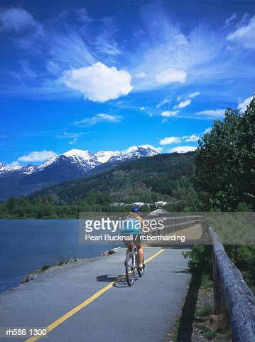 Cyclist on Valley Trail in summer beside Green Lake in the Whistler valley, Whistler, British Columbia, Canada, North America : Stock Photo