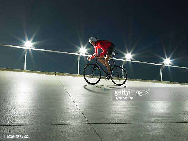Cyclist on velodrome track, low angle view