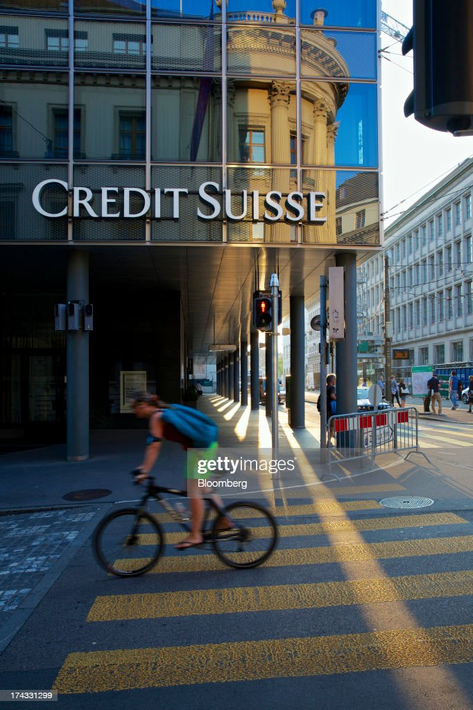 A cyclist passes a Credit Suisse Group AG branch in Basel, Switzerland, on Tuesday, July 23, 2013. Europe's biggest banks, which more than doubled their highest-quality capital to $1 trillion since 2007 to meet tougher rules, may have further to go as regulators scrutinize how lenders judge the riskiness of their assets. Photographer: Gianluca Colla/Bloomberg via Getty Images