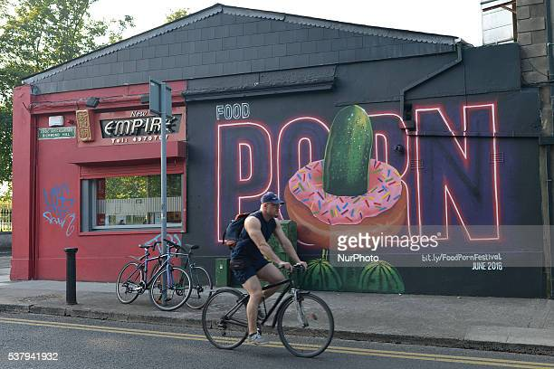 A cyclist passes near the mural add for the Dublin Food Porn Festival 2016 a new festival which aims to showcase the camera skills of Dublins amateur...