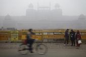 A cyclist passes police barricades in front of the Red Fort shrouded in haze in New Delhi India on Monday Jan 20 2014 India China and Brazil three of...