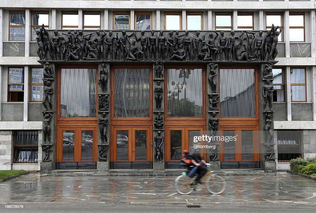 A cyclist passes the entrance to the Slovenian national assembly building in Ljubljana, Slovenia, on Monday, May 6, 2013. Slovenia plans to increase taxes to make up for the swelling budget shortfall as the country works to recapitalize its banks. Photographer: Chris Ratcliffe/Bloomberg via Getty Images