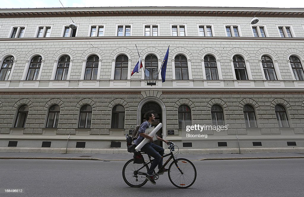 A cyclist passes the government and presidential palace building in Ljubljana, Slovenia, on Thursday, May 9, 2013. The Adriatic nation is seeking to fix its ailing lenders with a cash injection of at least 900 million euros ($1.17 billion) after Cyprus's bailout focused investors on countries with weak banking industries. Photographer: Chris Ratcliffe/Bloomberg via Getty Images