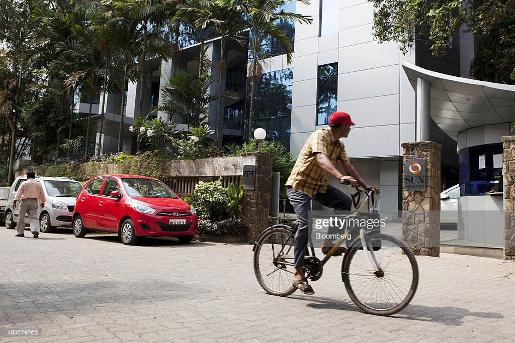 A cyclist passes the Sun Pharmaceutical Industries Ltd. corporate office in the Andheri suburb of Mumbai, India, on Monday, April 7, 2014. Sun Pharmaceutical, India's largest drugmaker by market value, agreed to buy Ranbaxy Laboratories Ltd. for $3.2 billion in stock, the biggest purchase by an Indian company in two years. Photographer: Amit Madheshiya/Bloomberg via Getty Images