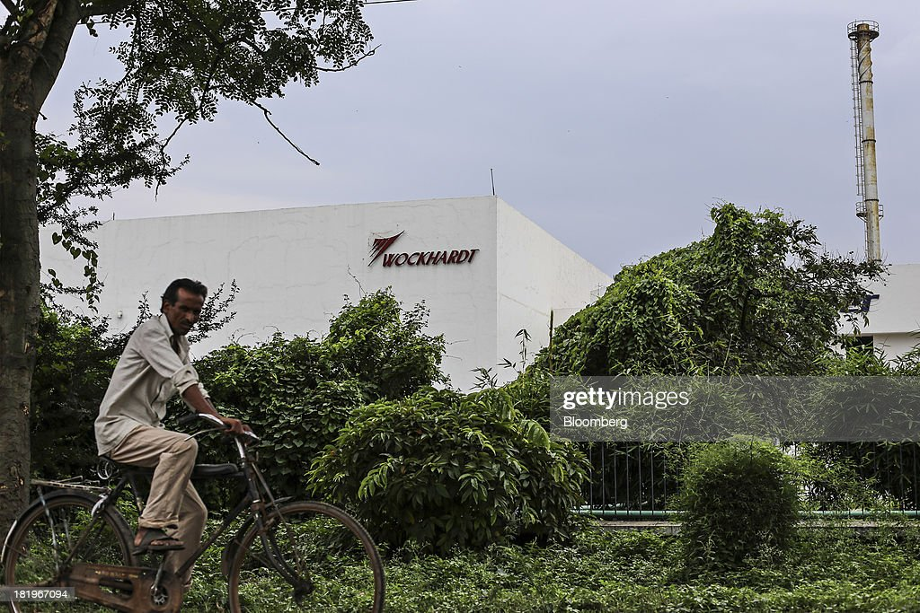 A cyclist passes the Wockhardt Ltd. manufacturing facility in the Waluj industrial area in Aurangabad, India, on Monday, Sept. 16, 2013. Wockhardt currently controls about 26 percent of the U.S. market for metoprolol, a generic version of the heart pill sold by London-based AstraZeneca Plc under the brand name Toprol-XL, according to Needham & Co. Metoprolol alone makes up about 14 percent of the company's 56 billion rupees in annual revenue. Photographer: Dhiraj Singh/Bloomberg via Getty Images