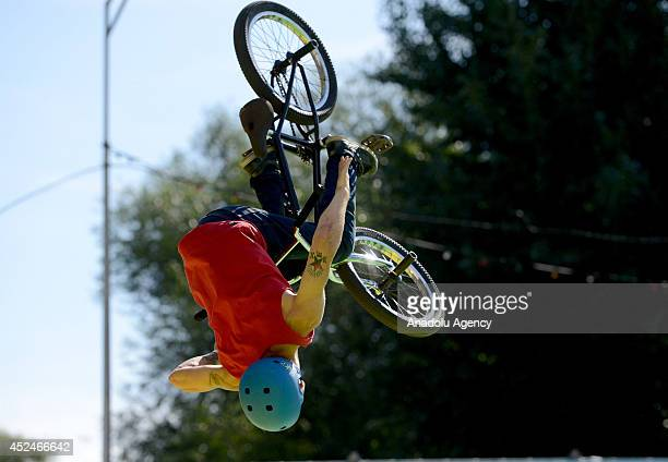 A cyclist performs during the BMX Bikes and Skateboard competition as a part of Adrenalin Games in Moscow Russia on July 21 2014