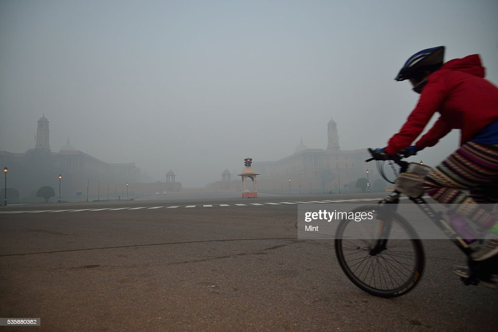 Cyclist practicing in early winter morning at Vijay Chowk on December 9, 2015 in New Delhi, India.