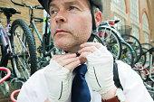Cyclist putting on cycling helmet