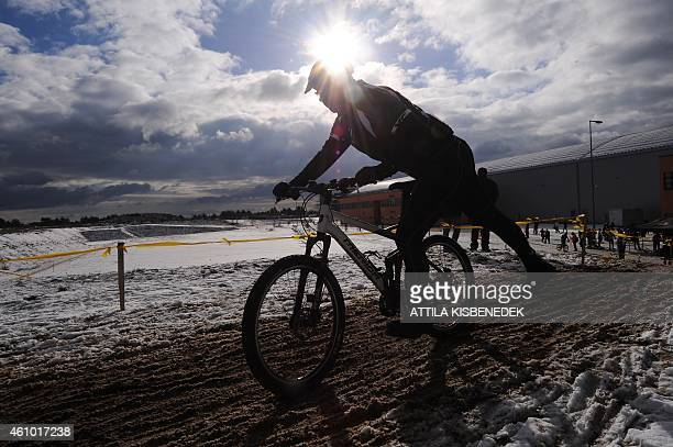 A cyclist races at the scene of the series of an US movie 'The Borgias' at Korda Movie Studios of Etyek town about 30 km west from Hungarian capital...