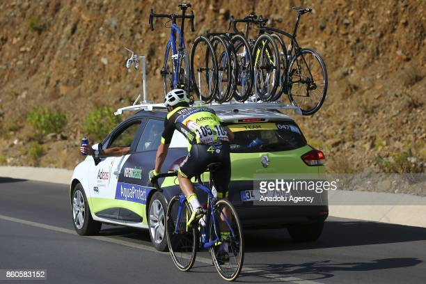 A cyclist receives water and energy drink aid during the third round of Fethiye Marmaris lap with the length of 1286 kilometers during the 53rd...