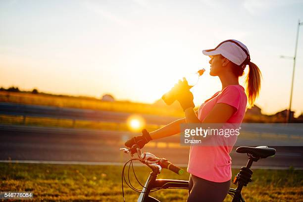 Cyclist refreshing with sport energy drink