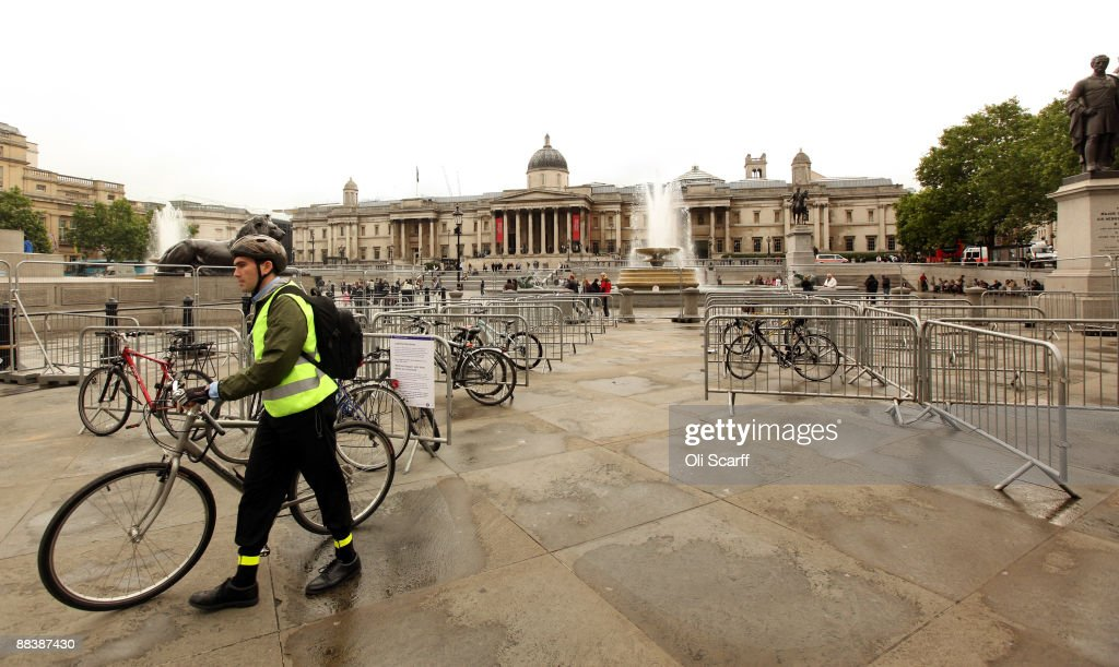 A cyclist removes his bike from an almost unused temporary, secure bike parking area provided in Trafalgar Square to assist commuters during the tube strike on June 10, 2009 in London, England. A 48 hour strike began at 7pm yesterday after discussions over pay and working conditions between London Underground bosses and the RMT Union failed to reach a conclusion.
